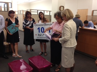 City Clerk Shirley Gentry (right) accepts petitions from Linda Curtis