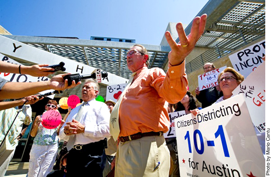 Bill Aleshire meets the press at a noon rally held by Austinites for Geographic Representation