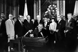 President Lyndon Johnson signs the Voting Rights Act of 1965