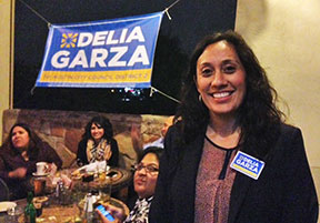 Delia Garza flashes a winning smile on election night