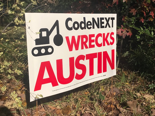 Signs similar to this one are displayed in front yards all over Austin.
