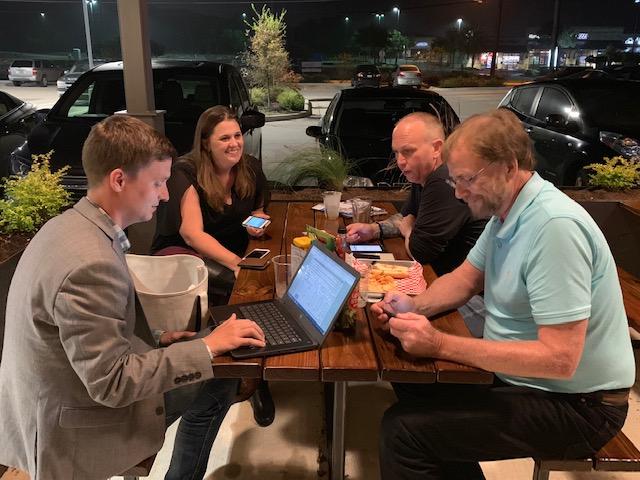 Bobby Levinski checks the votes while sister Mindi Metzler, Shane Sexton and Bryan King wait for updates