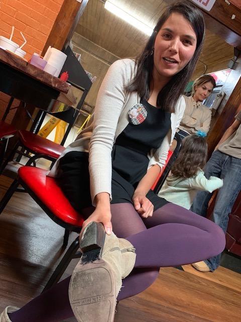 Mariana Salazar shows the heels of her shoes worn down in campaigning door to door.